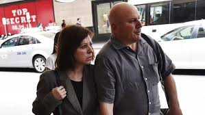 Maria Butera and partner after giving alleged perjured evidence at the Royal Commission