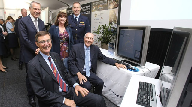 Airservices chairman Sir Angus Houston and Acting Prime Minister and Minister for Infrastructure Warren Truss – front – with Thales Australia CEO Chris Jenkins, Airservices CEO Margaret Staib and Chief of Air Force Air Marshal Geoff Brown at OneSky signing ceremony. February 2015 (Airservices)